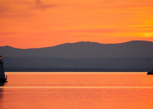 Lighthouse sunset lake champlain