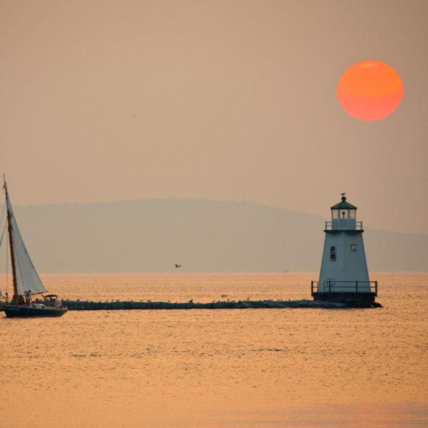 Lighthouse and sunset over Lake Champlain